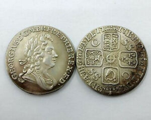1717 :Four Crowned Cruciform Shields Obverse: GEORGE I  Shilling Armored Bust