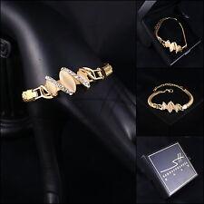 Armband, Armschmuck, Bracelet *Schlange* Gelbgold pl., Swarovski Elements, +Etui