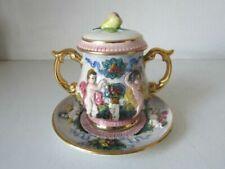 Statuine di porcellana e ceramica
