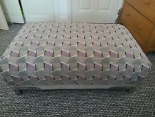 Large footstool pouffe used