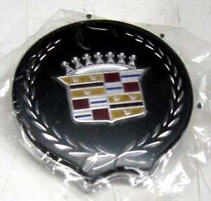 LATE MODEL CADILLAC TRUNK LOCK EMBLEM NEW GM NOS OLD STOCK