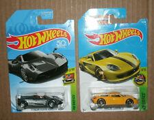 Two 1/64 Scale Hot Wheels Exotics - Porsche Carrera GT + Pagani Huayra Roadster