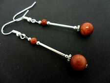 A PAIR OF DANGLY GOLDSTONE  BEAD  SILVER PLATED DROP EARRINGS.