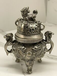 CASt IRON CHINESE DRAGON AND FOO DOG STATUES INCENSE BURNER.