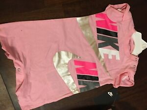 """nike baby girl pink one piece 6 month with multicolored """"Nike"""" wrote across"""