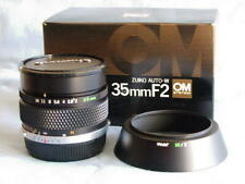 OLYMPUS OM ZUIKO 35mm F2 LENS WITH HOOD NEW IN BOX LATER MC VERSION