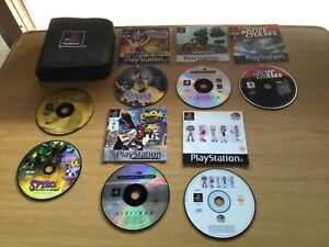 BULK LOT OF PS1 GAMES /PS CARRY CASE