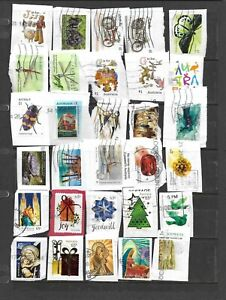 60 recent Australian stamps on paper - see scans