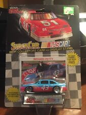 Racing Champions Richard Petty #43 STP Oil Treatmen w/Card & Display 1:64th 1990