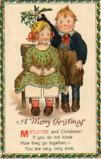 merry christmas - girl and boy with miseltoe early 1900s