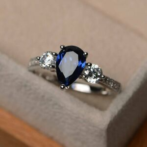 3CT Pear Cut Blue Sapphire & Diamond Trilogy Engagemnt Ring 18K White Gold Over