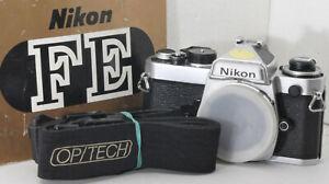 Nikon FE 35mm manual focus SLR camera body w/ IM, strap, battereis, new seals
