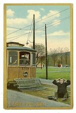 VINTAGE COMIC POSTCARD MAN SITTING ON TRACKS TROLLEY CAR CONDUCTOR RUN OVER