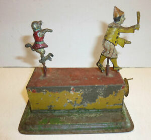 """Early tin crank penny toy for parts or restoration, spinning clown & dog, 4"""" T"""