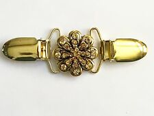 The mattie waist cinch gold tone and yellow stone flower clip