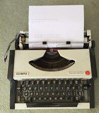 Olympia Traveller de Luxe Mechanical Typewriter - Italic Script
