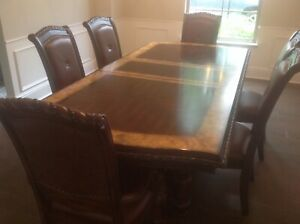dining table set. Table, two extension leafs, and four chairs and two head chair