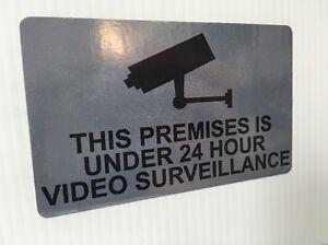 This Premises Is Under 24 Hour Video Surveillance - Metallic Silver Sticker