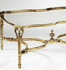 Neo Classic gold brass coffee table with antique finish and clear glass top