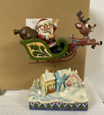 Jim Shore Rudolph Red Moses Reindeer Santa Sleigh over Village Rooftop New
