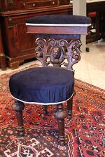 Chaise de fumeur XIXe en chêne massif sculpté de style Louis XIII