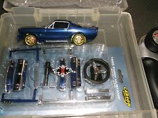 XMODS Gen 2 Euro dark blue 65 Mustang AWD stage 2 motor and spare body kit