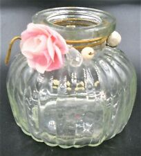 GLASS POT WITH PINK FLOWER AND BEADS