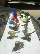 Lot of 16 vintage glass and art pottery bird figurines.