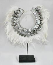 Tribal Shell Necklace with White Feathers on a wood and metal stand