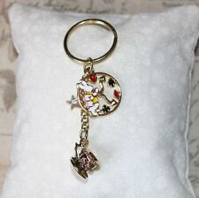 Alice in Wonderland themed gold tea cup & enamel White Rabbit clock Keyring