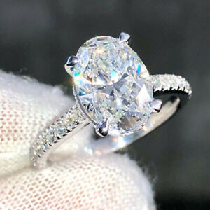 2.64 TCW Oval Cut Moissanite Hidden Halo Engagement Ring 14k White Gold Plated