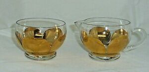 Vintage clear glass creamer pitcher and sugar bowl set with gold petal décor