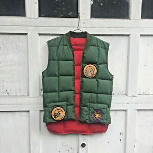 Vintage red green puffer hunting vest w/ Thompson arms, NRA, muzzle patches Sz L