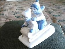 Porcelana de Cuernavaca Mexico 1992. Chidren on Bobsled Sculpture Figurine