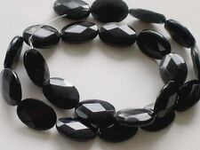 Black onyx faceted flat oval beads 18x13mm. Black gemstone beads