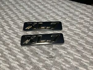 2003 Suzuki XL-7 right and left front fender mounted emblems OEM