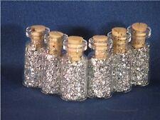 SILVER FLAKES IN 18 MINI GLASS BOTTLES NO LIQUID