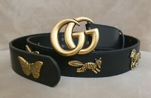 Gucci  black belt with golden tone creatures