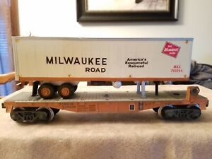 LIONEL - MILWAUKEE ROAD - 100499 FLATCAR WITH TRAILER