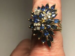 14kt gold diamond and sapphire waterfall ring size 7.5 Appraised at $4,065