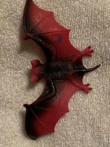 BLACK & RED  RUBBER BAT  About 2 ½  inches long and about 5 inches wide.  Nice