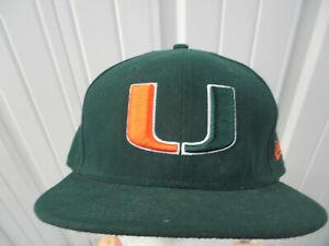 VINTAGE NEW ERA X UM MIAMI HURRICANES LOGO SEWN 7 1/2 GREEN FITTED CAP HAT 90s