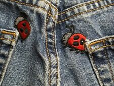 Abercrombie & Fitch women's jeans size 28x32 button fly ladybug patches bootcut