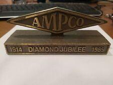 Amp Co Diamond Jubilee 1914-1989 desktop Paperweight