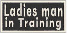 Ladies man in Training. Iron On Patch Funny  Biker Emblem  White  Border