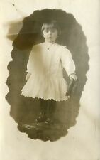 POST CARD OF A REAL PHOTOGRAPH OF A YOUNG GIRL DRESSED UP IN A STUDIO 1900'S