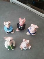 A SET OF 5 WADE NATWEST PIGS.