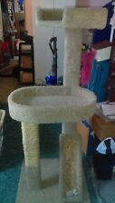 54 in Tan 2-tier used cat tree with 2 scratching posts, one rope other cardboard