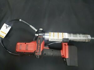 Snap on grease gun with one battery and one charger