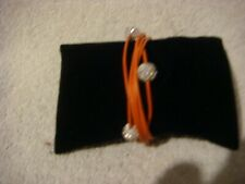 Shamballa style  multi standed bracelet in orange and silver